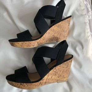 Black wedge sandals with black straps. Size 7.5